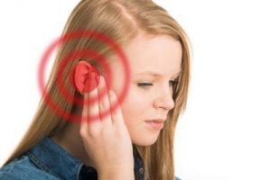 Пищене в ушите, симптоми и билки